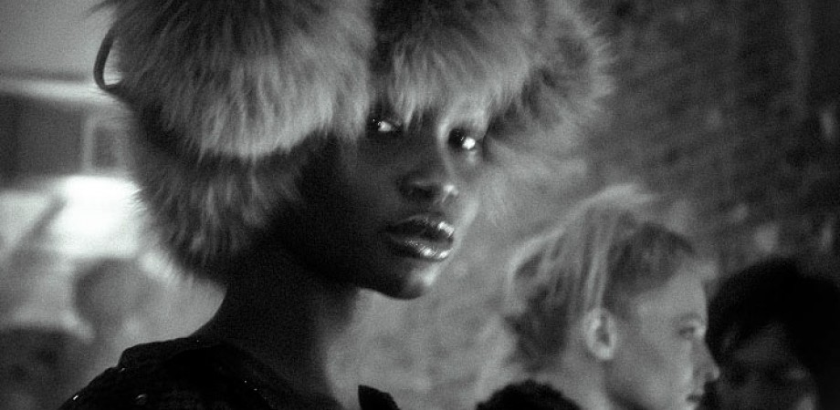 Photograph by Artist Danny Roberts of Trump Sudan Model Ataui Deng. Portrait is Semi Focused black and white picture at Chris Benz girl with furry hat on stairing into the camera.