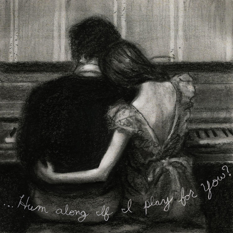 私があなたのために演奏するときに柔らかく歌う couple at the piano