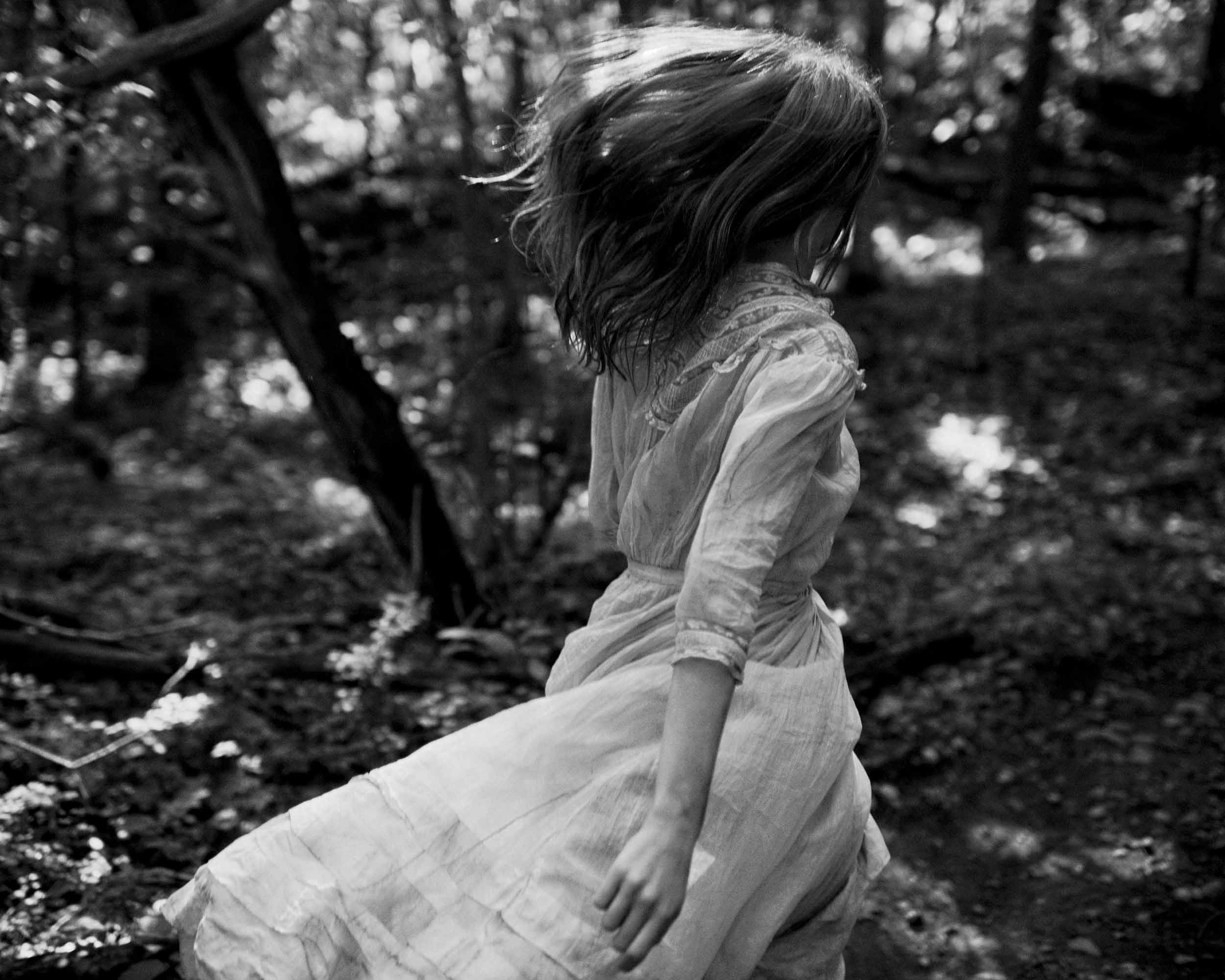 Julia Hafstrom running in the forest black and white danny roberts