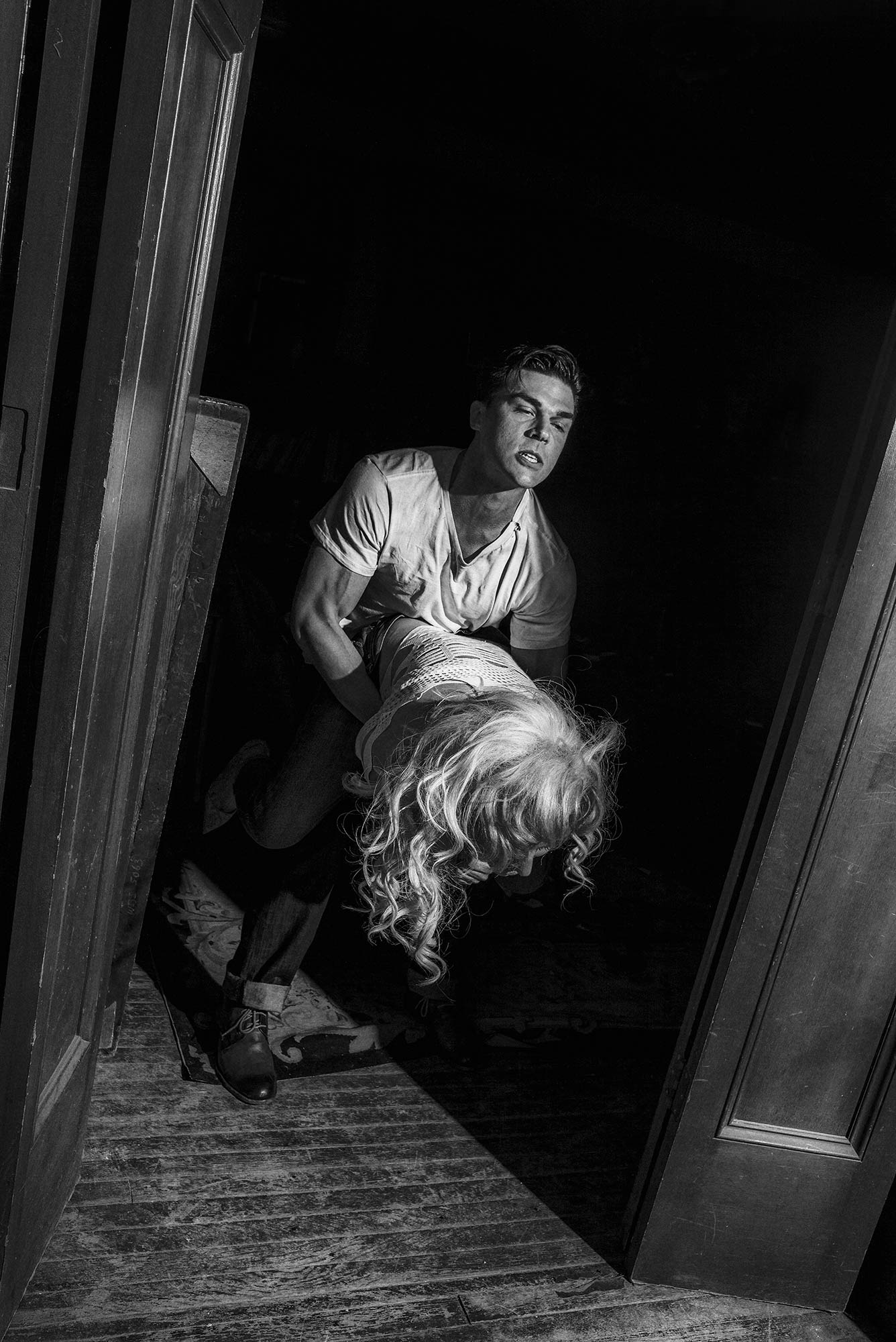 A Photo of Finn Wittrock Lifting lady gaga v magazine shoot by Chadwick Tyler american horror show