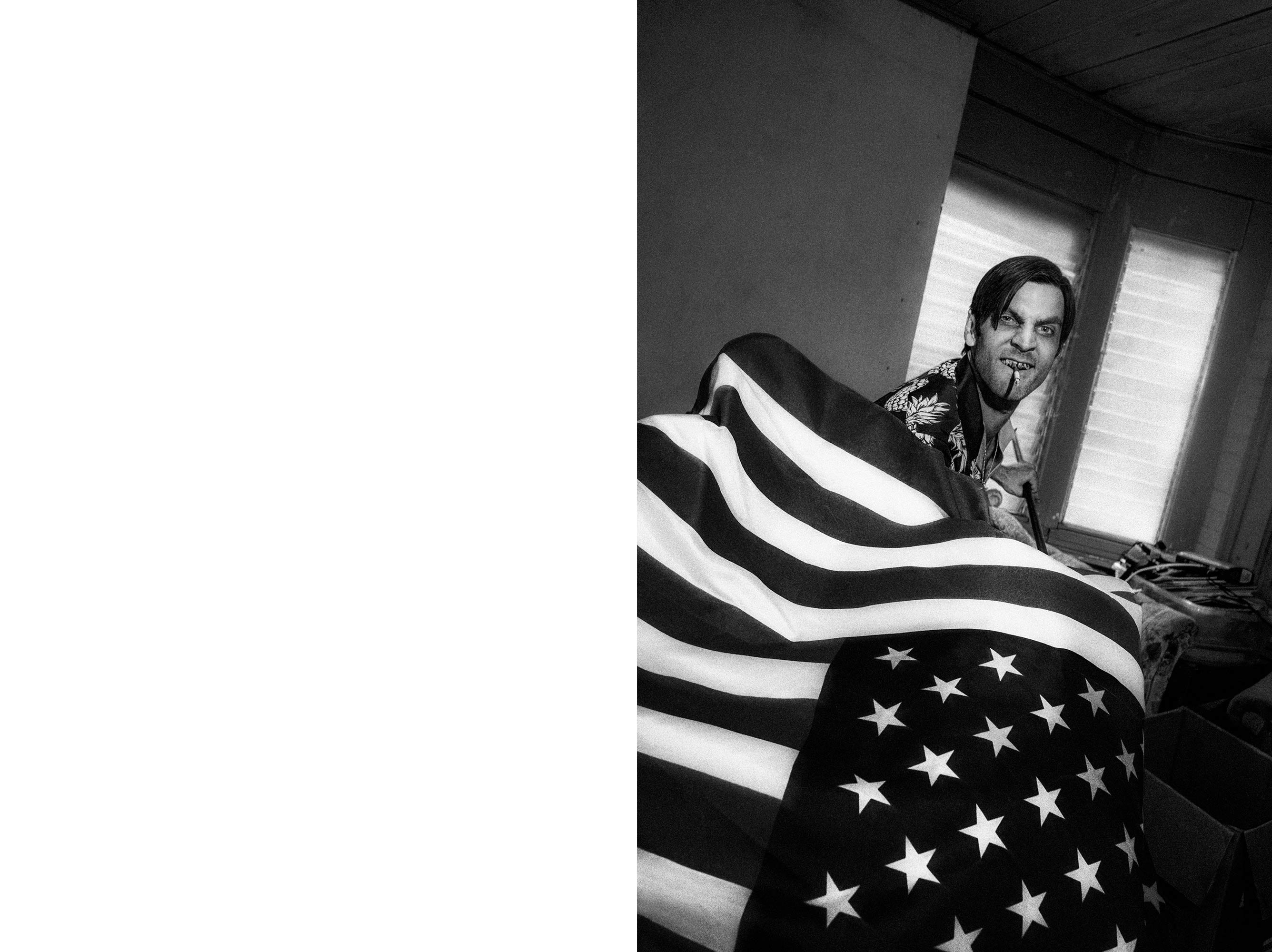 Photo of Wes Bentley holding american flag for lady gaga v magazine shoot by Chadwick tyler