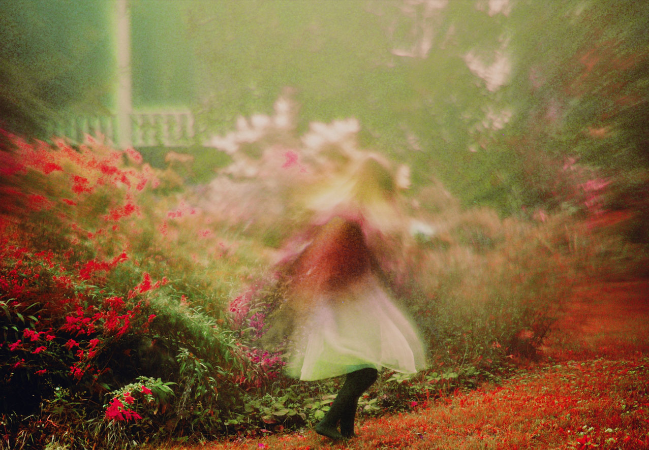 photographer Amber Ortolano surreal colorful photo os girl walking through a dream